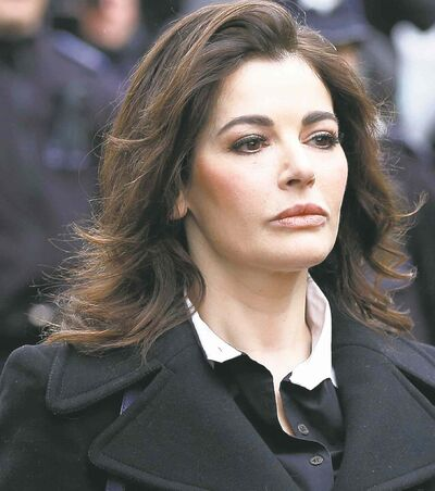 Celebrity chef, Nigella Lawson, arrives at Isleworth Crown Court in London. Two former assistants to Nigella Lawson and her former husband were acquitted of fraud Friday, Dec. 20, 2013 in London, capping a case where allegations of unauthorized spending on lavish goods were often overshadowed by titillating glimpses into the celebrity chef's troubled home life.