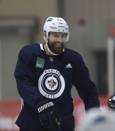 RUTH BONNEVILLE / WINNIPEG FREE PRESS</p></p></p><p>Winnipeg Jets player, #26 Blake Wheeler smiles while talking to .Jack Roslovic #28 during practice at Iceplex Tuesday. Story about Wheeler signing a five-year contract extension.</p></p><p>See Jay Bell story.</p></p><p>September 4/18</p>