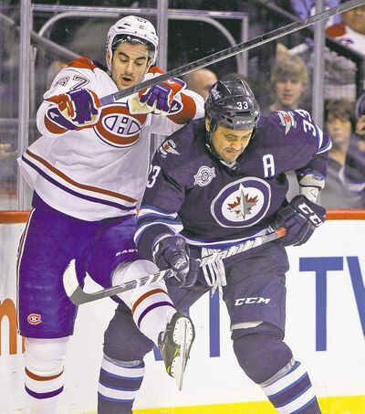 trevor hagan / winnipeg free press archivesDustin Byfuglien, third in scoring among NHL defencemen with 46 points, says minor issues are common late in the season.