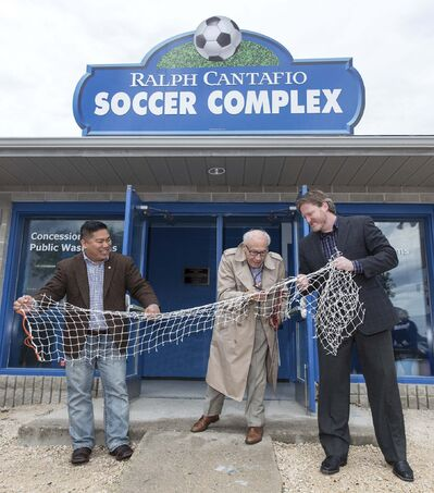 photos by MIKE DEAL / WINNIPEG FREE PRESS</p><p>Ralph Cantafio Sr. prepares to cut a soccer net to officially rename the Winnipeg Waverley Soccer Complex to the Ralph Cantafio Soccer Complex in his honour Sunday morning. He is flanked by Winnipeg City Councillor Mike Pagtakhan (left) and Matthew Duffy with the Winnipeg Soccer Federation.</p>
