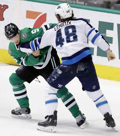 LM OTERO / THE ASSOCIATED PRESS</p><p>Winnipeg Jets left wing Brendan Lemieux (48) and Dallas Stars defenseman Connor Carrick (5) fight during the first period of an NHL hockey game in Dallas, Saturday, Jan. 19, 2019.</p>