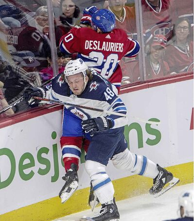 Winnipeg Jets left wing Brendan Lemieux checks Montreal Canadiens left wing Nicolas Deslauriers during the first period.