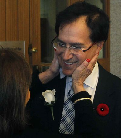 Councillor Marty Morantz for Charleswood-Tuxedo is congratulated by his mother Pearl Morantz after his swearing-in ceremony at the City Hall Friday.