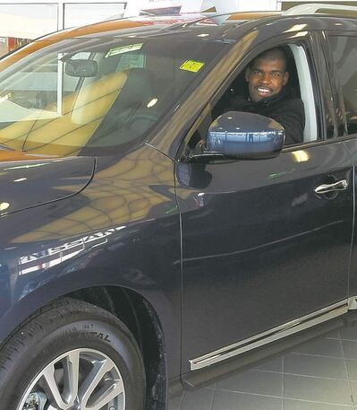 Former Winnipeg Blue Bomber and NFL football player Kelly Butler, above, at his new job at Crown Nissan in the 2013 Pathfinder.