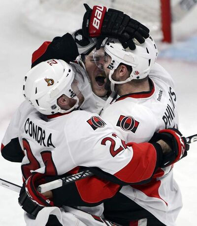 Senators centre Kyle Turris (middle) celebrates with teammates Erik Condra and Chris Phillips to put Ottawa up 3-1 in the second period Thursday.