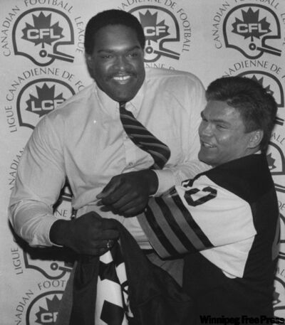 Nick Benjamin (left) and Jed Tommy joke around after being selected in the first round of the CFL college draft in Toronto in 1985. Benjamin, a former offensive lineman for the Ottawa Rough Riders and Winnipeg Blue Bombers, died last August following a lengthy battle with kidney disease.