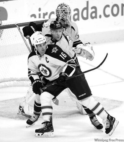 TREVOR HAGAN / WINNIPEG FREE PRESSJets captain Andrew Ladd is shadowed by Nashville Predators� Tyler Sloan in front of Preds� goalie Anders Lindback in the second period Friday.  Head coach Claude Noel is impressed by the leadership of not only Ladd but a handful of other players as well.