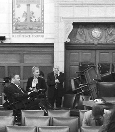 Manitoba MP Steven Fletcher stayed next to the door in a parliamentary meeting room after gunfire  erupted in the hallway Wednesday.