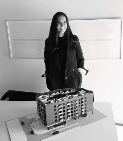 Karen Shanski, owner and lead architect with BLDG architecture office inc., poses with a maquette of the firm's Market Avenue project.