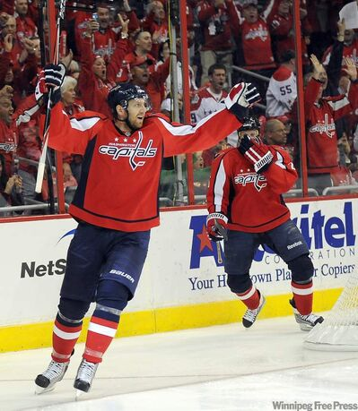 Former Washington Capitals right wing Eric Fehr celebrates after scoring against the Tampa Bay Lightning during the second period of Game 1 of the NHL Eastern Conference Semifinals Playoffs at the Verizon Center Friday, April 29, 2011. Fehr was traded to Winnipeg.