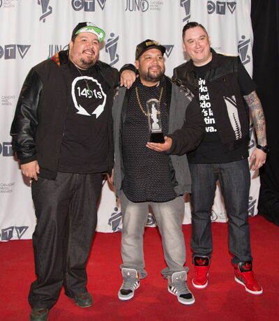 A Tribe Called Red receives the 2014 JUNO for Breakthrough Group of the Year at the MTS Centre in Winnipeg on March 30, 2014.