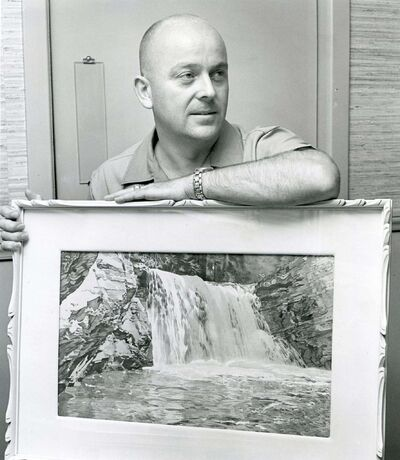 WINNIPEG FREE PRESS files</p><p>John Crabb is shown in 1967 with one of his many paintings by Walter J. Phillips.</p>