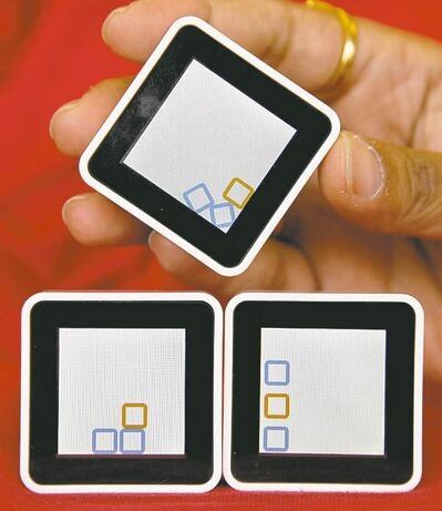 Sifteo Cubes are photographed, in New York, Wednesday, Aug. 24, 2011. Sifteo Cubes exist in that rare but intriguing realm between digital video games and hands-on-toys, an experience that's both on-screen and tactile. (AP Photo/Richard Drew)