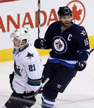 Winnipeg Jets' Andrew Ladd (16) celebrates after scoring on San Jose Sharks' goaltender Antti Niemi during the first period of NHL hockey action in Winnipeg.