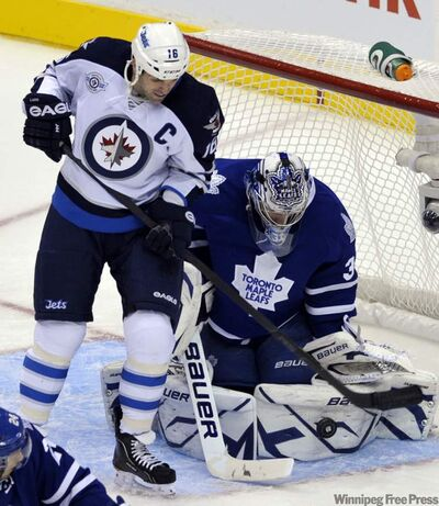 Toronto Maple Leafs goalie James Reimer makes a save behind Winnipeg Jets forward Andrew Ladd during their game in Toronto Wednesday. The Jets face Ottawa next.