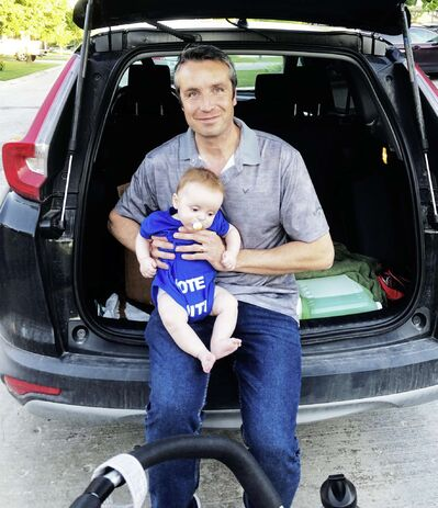 Andrew Smith — pictured here with his six-month-old son, Lincoln — is the Progressive Conservative candidate in the newly defined provincial riding of Lagimodière.