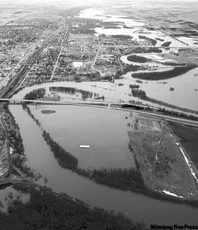An aerial view of the Assiniboine River spilling over its banks in Brandon.