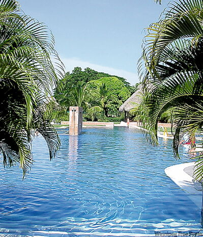 Poolside at the Decameron Resort, Panama's most luxurious hotel, now working out growing pains.