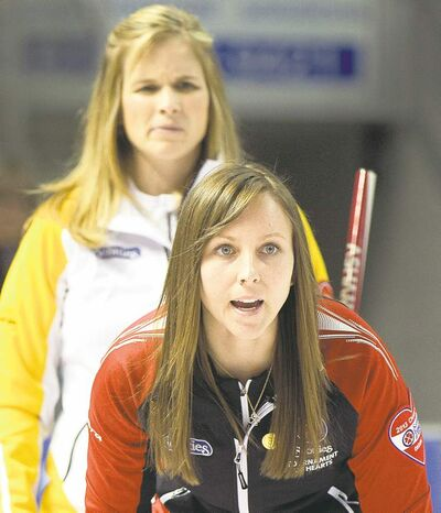 Ryan Remiorz / the canadian pressManitoba skip Jennifer Jones appears somewhat puzzled as Ontario�s Rachel Homan shouts orders at her sweepers Saturday night.