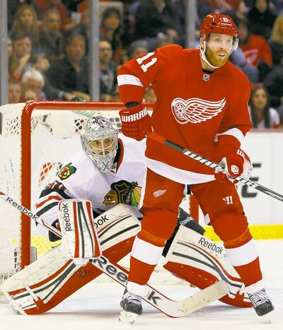 Red Wings' Danny Cleary tries to screen Blackhawks goalie Corey Crawford in the first period Thursday in Detroit. The Wings won 2-0 and lead the West semifinal 3-1.