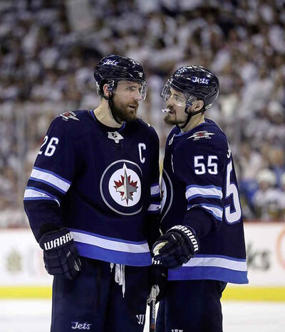Winnipeg Jets' captain Blake Wheeler, left, will be entering the final year of his current contract.