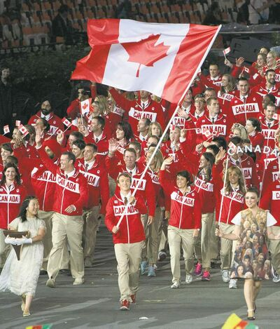 Sean Kilpatrick / THE CANADIAN PRESSTriathlete Simon Whitfield carries the Maple Leaf for Team Canada as they parade in the Olympic Stadium during the opening ceremonies Friday.