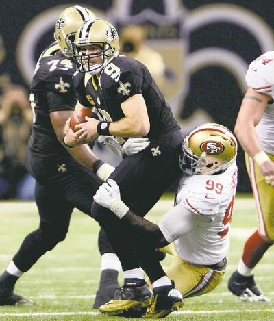 Bill Feig / the associated press archivesSaints QB Drew Brees hopes to escape the clutches of San Francisco defenders today in the Big Easy.