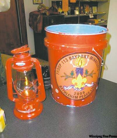 Joe Reding's Boy Scouts of America official lantern and fireproof bucket used to transport the Bethlehem Peace Light.