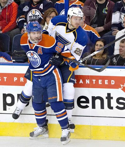 The Oilers' Sam Gagner checks the St. Louis Blues' Ian Cole during Saturday's 6-0 loss in Edmonton.