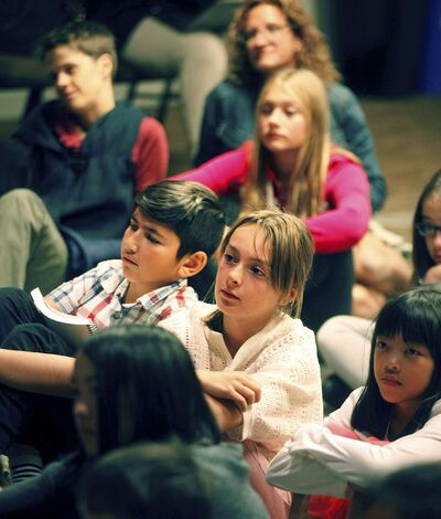 <p>A select group of school children listen Dr. Jane Goodall speak at a workshop for school kids Thursday afternoon.</p>