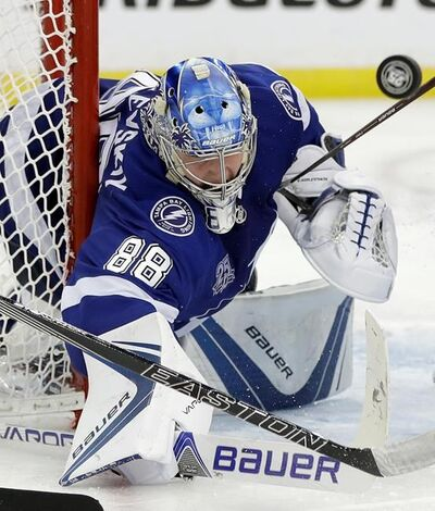 Tampa Bay Lightning goaltender Andrei Vasilevskiy makes a stick save on a shot by the New Jersey Devils during the third period of Game 2 of an NHL first-round hockey playoff series Saturday, April 14, 2018, in Tampa, Fla. The Lightning won 5-3. (AP Photo/Chris O'Meara)