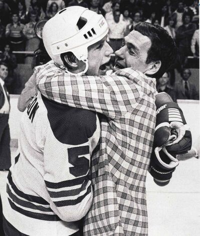 A jubilant coach, Tom McVie, and one of his players, Kim Clackson, celebrate Winnipeg Jets' Avco Cup win in 1979.