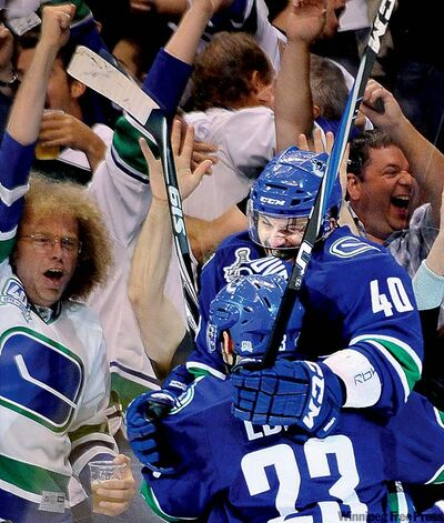 Vancouver's Maxim Lapierre (40) whoops it up with teammate Alexander Edler after scoring Friday's game-winner.
