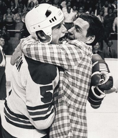 PAUL DELESKE / WINNIPEG FREE PRESS FILES</p><p>Jets coach Tom McVie, who stepped behind the bench late in the season, celebrates the Jets championship with defenceman Kim Clackson.</p>