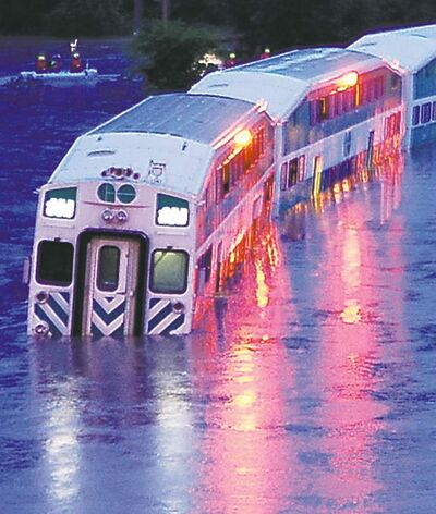 A GO Train is stranded on flooded tracks in Toronto on Monday, July 8, 2013. THE CANADIAN PRESS/Winston Neutel