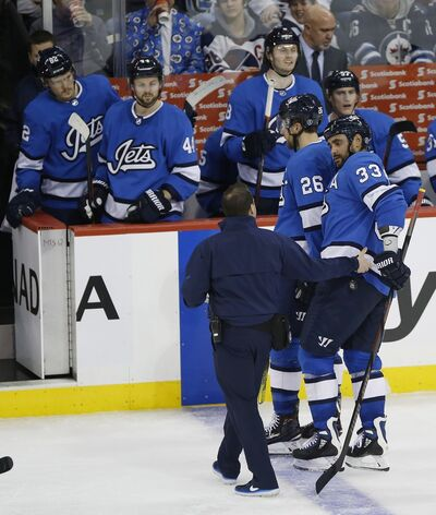 Byfuglien is helped off the ice by a trainer during a game in December of 2018. The Jets defenceman would suffer three different injuries and miss almost half the games that season due to injury.