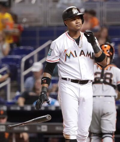 Miami Marlins' Starlin Castro drops his bat after striking out swinging in the fourth inning of a baseball game against the San Francisco Giants, Thursday, June 14, 2018, in Miami. (AP Photo/Lynne Sladky)