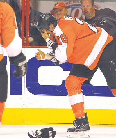 Ron Cortes / Philadelphia Inquirer / MCT archivesChris Pronger goes to the locker-room after taking a high stick in his eye on Oct. 24, 2011.