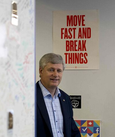 Stephen Harper enters the offices of Facebook to interact with his supporters online.