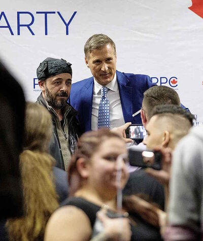 Bernier posed for selfies with some of the roughly 250 people attending his rally at the Airport Holiday Inn in Winnipeg, Wednesday evening.