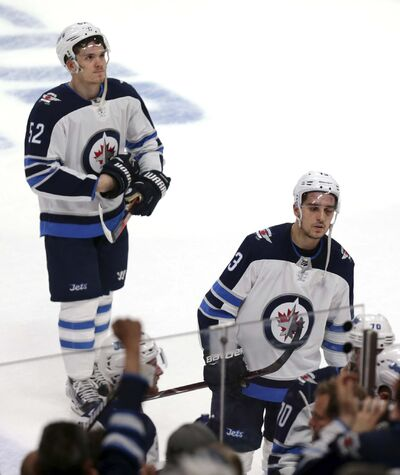 (AP Photo/Andy Clayton-King)</p><p>Winnipeg Jets players Jack Roslovic, left, and Brandon Tanev skate off the ice after losing to the Minnesota Wild, Sunday.</p>