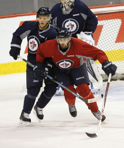 Winnipeg Jets centre Eric O'Dell #58 works against defense #39 Tobi Enstrom during practice in this file photo from April.