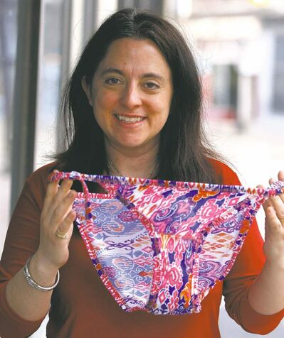 Rachel Starkey shows underwear her company makes from waste cloth.
