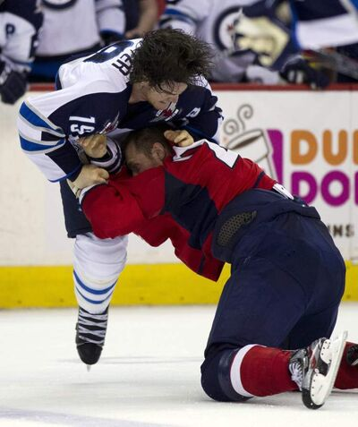 Centre Jim Slater put the fight back into the Jets with his second-period tussle with the Caps' Brooks Laich.