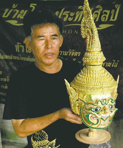 Prateep Rodpai, one of Thailand's last traditional Khon mask makers, holds a Khon mask at his home in Bangkok, Thailand. These types of masks are the keystones of ornate glittering costumes used in the stylized classical Thai dance form known as Khon.