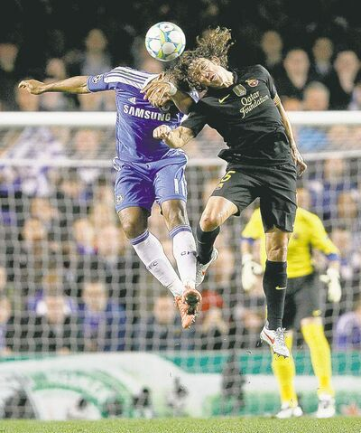 Kirsty Wigglesworth / the associated pressChelsea�s Didier Drogba (left) leaps to head the ball with Barcelona�s Carles Puyol during their Champions League match at Chelsea�s Stamford Bridge Wednesday.