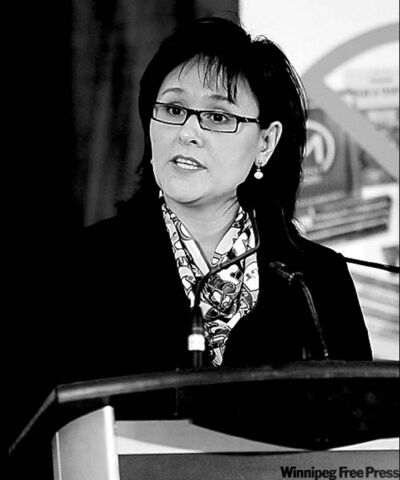 Health Canada handou Federal Health Minister Leona Aglukkaq engaged in public spat with Manitoba Health Minister Theresa Oswald (left).