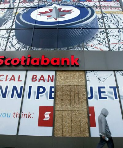 Sheets of wood fill a windowpane in the front of the Scotiabank at the intersection of Portage and Main after it was reportedly vandalized Sunday night.