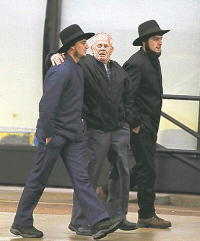 Amish men walk to the U.S. Federal Courthouse on Friday.