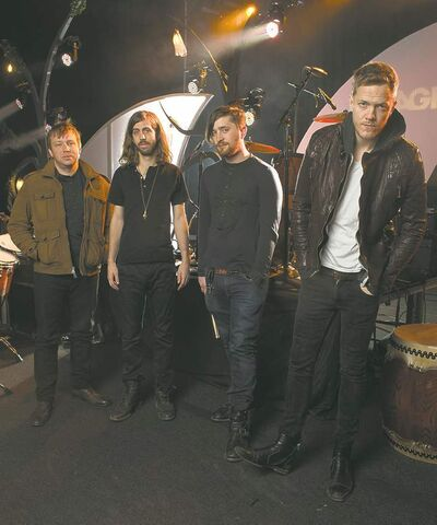 In this Feb. 6, 2013 photo, Las Vegas-based rock band Imagine Dragons, from left, Ben McKee, Wayne Sermon, Dan Platzman and Dan Reynolds pose for a group portrait in Las Vegas. The band's debut album �Night Visions,� has reached gold status and features the hits �It�s Time� and �Radioactive.� The foursome, signed to music producer Alex da Kid�s label imprint, is currently on a U.S. tour. (Photo by Al Powers/ Powers Imagery/Invision/AP)